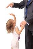 Hombre de negocios con la pequeña hija. Fotos de archivo