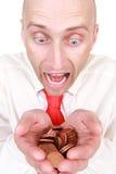 Hombre de negocios con la pila de monedas Imágenes de archivo libres de regalías