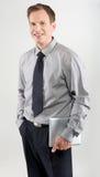 Hombre de negocios con la tablilla Imagen de archivo libre de regalías