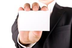 Hombre de negocios con la tarjeta de felicitación fotografía de archivo