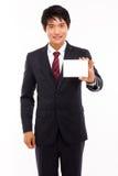 Hombre de negocios con la tarjeta en blanco. Imágenes de archivo libres de regalías
