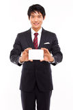 Hombre de negocios con la tarjeta en blanco. Fotografía de archivo