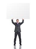 Hombre de negocios con la tarjeta en blanco Fotos de archivo