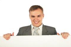 Hombre de negocios con la tarjeta para el texto Imágenes de archivo libres de regalías