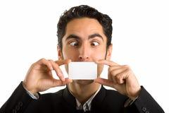 Hombre de negocios con la tarjeta plástica. Humor. Foto de archivo