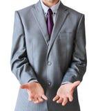 Hombre de negocios con las manos abiertas en la parte inferior, aislado en el backgr blanco Foto de archivo libre de regalías
