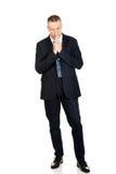 Hombre de negocios con las manos apretadas Imagen de archivo