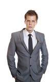 Hombre de negocios con las manos en bolsillos Fotos de archivo