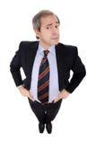 Hombre de negocios con las manos en sus caderas imagenes de archivo