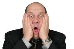 Hombre de negocios con las manos a la cara fotos de archivo