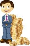 Hombre de negocios con las monedas de oro Foto de archivo libre de regalías