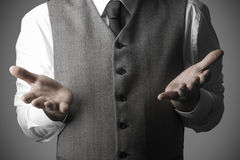 Hombre de negocios con las palmas abiertas de la mano, concepto del negocio Imágenes de archivo libres de regalías
