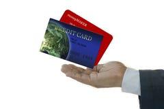 Hombre de negocios con las tarjetas de crédito Fotografía de archivo libre de regalías