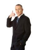 Hombre de negocios con llamada yo gesto Imagenes de archivo