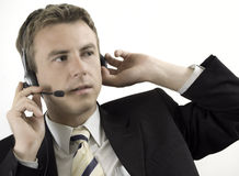Hombre de negocios con los auriculares Imagen de archivo libre de regalías