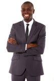 Hombre de negocios con los brazos cruzados Fotografía de archivo