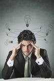 Hombre de negocios con los bulbos de lámpara quebrados Fotografía de archivo libre de regalías