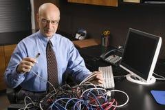 Hombre de negocios con los cables Imágenes de archivo libres de regalías