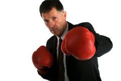 Hombre de negocios con los guantes de boxeo encendido Fotografía de archivo
