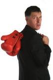 Hombre de negocios con los guantes de boxeo encendido Fotografía de archivo libre de regalías