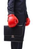 Hombre de negocios con los guantes rojos del boxeador Foto de archivo libre de regalías