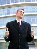 Hombre de negocios con los pulgares para arriba Fotos de archivo