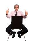 Hombre de negocios con los pulgares para arriba Fotos de archivo libres de regalías