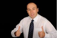 Hombre de negocios con los pulgares para arriba Foto de archivo libre de regalías