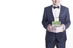 Hombre de negocios con los regalos (imagen horizontal) Imagenes de archivo