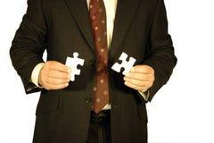 Hombre de negocios con los rompecabezas Fotografía de archivo libre de regalías