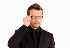 Hombre de negocios con los vidrios que miran la cámara Imagenes de archivo