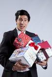 Hombre de negocios con muchos conjuntos del regalo Imagen de archivo libre de regalías