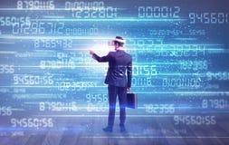 Hombre de negocios con números variables alrededor Imagen de archivo