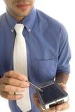 Hombre de negocios con PDA fotos de archivo