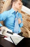 Hombre de negocios con problemas de salud fotografía de archivo libre de regalías