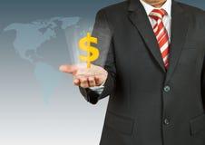 Hombre de negocios con símbolo del dólar sobre su mano Fotos de archivo libres de regalías