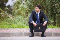 Hombre de negocios con su monopatín Imagen de archivo libre de regalías