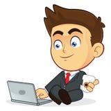 Hombre de negocios con su ordenador portátil Imagen de archivo libre de regalías
