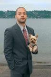 Hombre de negocios con su perro imágenes de archivo libres de regalías