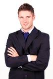 Hombre de negocios con sus brazos plegables Imagenes de archivo