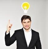 Hombre de negocios con un bulbo de la idea Fotografía de archivo