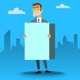 Hombre de negocios con un cartel y lugar para el texto Imágenes de archivo libres de regalías