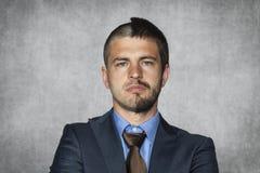 Hombre de negocios con un corte de pelo imagenes de archivo