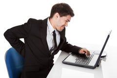Hombre de negocios con un dolor más de espalda Foto de archivo libre de regalías