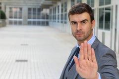 Hombre de negocios con un gesto de mano de la PARADA fotos de archivo libres de regalías