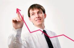 Hombre de negocios con un gráfico Imagenes de archivo