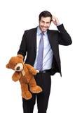Hombre de negocios con un oso de peluche fotos de archivo libres de regalías