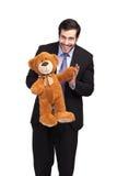 Hombre de negocios con un oso de peluche Imagen de archivo libre de regalías