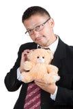 Hombre de negocios con un oso de peluche Fotografía de archivo libre de regalías