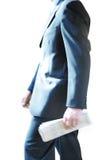 Hombre de negocios con un periódico Imágenes de archivo libres de regalías